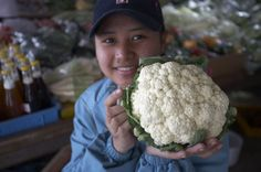 Cameron Highlands - Girl holding a cauliflower in the market  #malaysia #southeastasia #asia #cameronhighlands #mountain #agriculture #explore #shopping #market #accommodation #resort #hotel #travel #traveltherenext #people