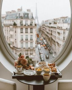 NgLp Designs shares Design Details ~ a room with a beautiful view of Paris, France. Oval window design framing a perfect view overlooking the Eiffel Tower, a romantic tabletop setting with breakfast for two Places To Travel, Travel Destinations, Places To Go, Holiday Destinations, Paris 3, Paris France, France Europe, Paris Night, Dinner In Paris