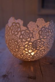 Soak lace doiles in glue, arrange on a blown up balloon, brush on 1 more coat of glue  let dry for at least 24 hrs. Pop balloon, carefully peel away  voila! You have a lace bowl!