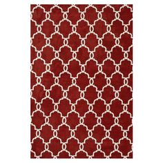 Add elegant appeal to your living room or den with this stylish rug, featuring a classic links motif in rust.   Product: Rug