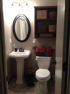 Bathroom storage pedestal sink small bathroom with pedestal sink tub and shower storage over toilet Small Pedestal Sink, Pedestal Sink Bathroom, Small Bathroom Vanities, Small Bathrooms, White Bathroom, Pedestal Sink Storage, Small Vanity, Mirror Bathroom, Bathroom Wallpaper