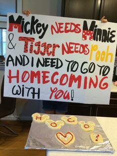 "a cute homecoming/dance asking idea! especial for a girl or guy who likes disney! ""Mickey needs Minnie and tigger needs pooh and I need to go to homecoming with you!"" the Mickey Mouse shaped sugar cookies spelling ""hoco"" are a plus :) hope you use this idea to ask a special someone to a dance!"