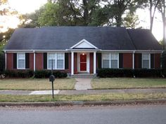 black shutters. black shutters. of Lovely Ranch style home of red brick ...