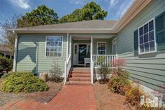 215 Rouen Ct, Wilmington, North Carolina 28412 This 3 bedroom, 2 bath one-owner home has been meticulously maintained and updated by the seller.  Hardwood floors enhance the spacious living room, which features easy access to the sunroom where you'll enjoy year-round living overlooking the mature landscaped back yard that backs up to the privacy of the woods. Recent upgrades include exterior paint, a garage door, leaf filter gutters, and irrigation.