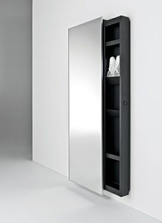 "Design: Salvatore Indriolo, 2010 / Mirror design evolves and integrates with new features. A fixed and safe mirror hides a metal storage container that slides left or right to reveal its contents. Customizable with adjustable shelves, this complement is a true ""home backstage"", which can also become the star performer at centre stage."