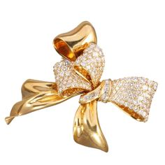 CHAUMET Diamond Yellow Gold Bow Brooch | From a unique collection of vintage brooches at http://www.1stdibs.com/jewelry/brooches/brooches/