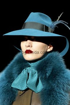 Teal Peacock blue ensemble, with puce lipstick serving for the icing on the cake.