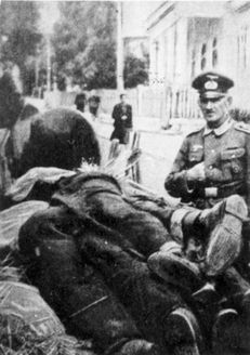 Katowice, Poland, A German soldier supervising the collection of Jewish dead bodies.