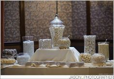 candy bar: all white and gold to match our theme!- the ferreo rochers were a big hit