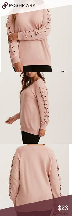 Torrid blush pink lace up sleeve sweatshirt Sweatshirts are chic now! As evidenced by this style. While the super-soft and snuggly blush pink French Terry knit and comfy pullover silhouette are standard sweatshirt fare, the oversize grommets that are stamped on the sleeves and threaded with thick lace up ties, elevate this sweatshirt to chic and unique status. torrid Sweaters