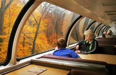 """The Prettiest Fall Train Trip in the U.S. Only Costs $58  -   Great Dome Car on Amtrak's Adirondack route. Departs daily from New York Penn Station, the Dome attached at the Albany stop, dense forests & mountains of upstate New York ending in Montreal. One-way tickets from Albany to Montreal start at just $53.  This is a """"for a limited-time only"""" type deal, since the window-covered car is typically only available to travelers on this route for about 6 weeks starting in late Sept."""