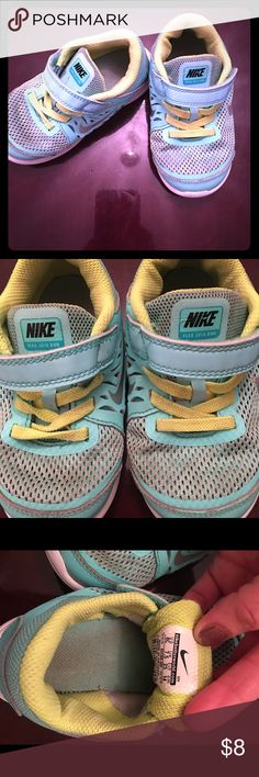 Nike's tennis shoes Nike tennis shoes, teal with yellow, have wear to them please look at pictures, I have washed them and have a lot of wear left to them. Nike Shoes Sneakers