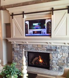 fireplace with barn over the mantle to cover the TV