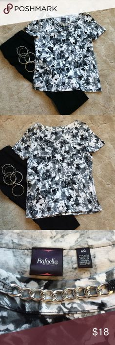Cute Black & white print Tee This is a tee features a black/gray/white floral pattern. It is accented with a silver chain o the front neckline. Very versatile...can go from work to a dinner date! Worn once. Excellent condition! Rafaella Tops Tees - Short Sleeve