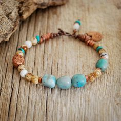 Lotus charm yoga bracelet by Saha Design Studio.