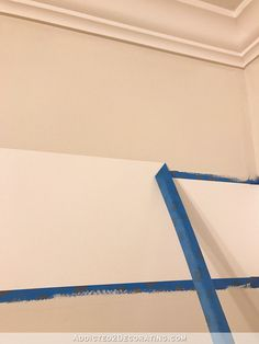 How to paint perfect stripes on a wall - 7 - remove tape by pulling at an angle away from the stripe