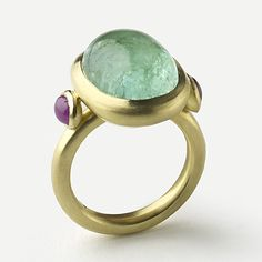 18 carat gold paraiba tourmaline and ruby by Julia Lloyd George: http://www.fldesignerguides.co.uk/engagement-ring-designer/julia-lloyd-george