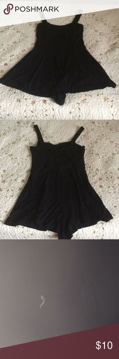 A black romper with a skort. His romper is medium and black with straps and a hole in the back (made that way) this can be worn for more warmer weather for a possible night out on the town if you want to feel a little sexy (: Forever 21 Shorts Skorts