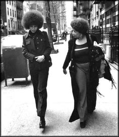 Angela Davis and Toni Morrison walking through Harlem in 1974.