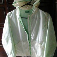 PETITE benneton jacket (windbreaker) For a 10 yr old size, as indicated in d tag. But it fit my  size xs 15 yr old niece. bought by mistake, 4 my daughter 6 yrs. Ago, perfect shape, pet n smoke free home.polymide, acrylic., resin, nylon. N  Interior is 100% polyester. 145 cm. Or 57 inches.machine wash cold Do Not dry clean.Do Not tumble dry. benneton Jackets & Coats Utility Jackets