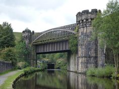 One of three self-contained cast iron arch railway bridges constructed as part of Stephenson's Manchester & Leeds Railway. This one, which crosses the Rochdale Canal, is the only one still in use. This type of bridge -- an arch supporting the deck system using hangers -- was introduced into Britain by George Leather, a Leeds engineer. It was first used for road bridges over rivers (1830s) and later for railway viaducts.  See also Stanley Ferry Aqueduct…