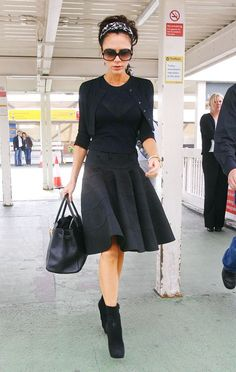 Victoria Beckham demostrates:  a) How to wear a head scarf  b) Making a traditional full, A-line skirt modern  c) How to wear booties without jeans
