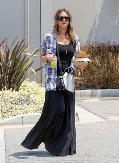 Jessica Alba wearing Dr. Martens 1460 Boots, Nina Ricci Python Marche Bag.