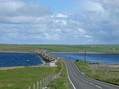The Churchill Barriers are a series of four causeways in the Orkney Islands, United Kingdom, with a total length of 1.5 miles (2.3 km). Churchill Barriers - They link the Orkney Mainland in the north to the island of South Ronaldsay via Burray and the two smaller islands of Lamb Holm and Glimps Holm.