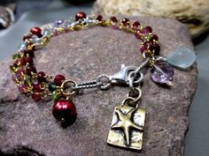 This Triple Strand Dream Bracelet is stunning! Three strands of nothing but luscious! Bracelet is made up from tourmaline, rubies, blue topaz, and more!