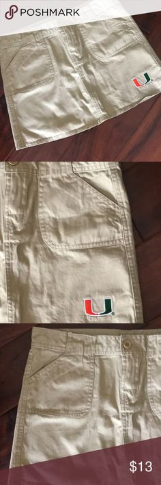 "University of Miami Hurricanes Tan Skirt University of Miami Hurricanes Adorable Khaki Tan Short Mini Skirt Size Small.  Cargo style pockets on the front.  Hidden style pockets on the back.  Has the Miami ""U"" in orange and green on the lower left bottom.  100% Cotton.  Buttons and zipper in the front.  Excellent condition.  No signs of wear.  Waist flat across =15"".  Length = 13"".  Thanks for looking and please feel free to ask questions! Knights Apparel Skirts Mini"