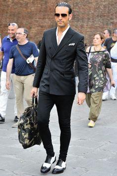 Shop this look for $447:  http://lookastic.com/men/looks/longsleeve-shirt-and-tote-and-brogues-and-chinos-and-double-breasted-blazer-and-pocket-square/1728  — White Longsleeve Shirt  — Dark Green Camouflage Canvas Tote  — Black and White Leather Brogues  — Black Chinos  — Black Double Breasted Blazer  — White and Black Vertical Striped Pocket Square