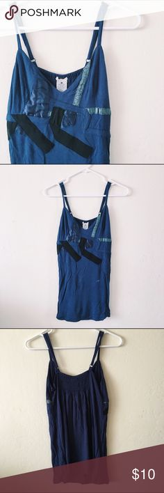 Urban Outfitters | ecote blue tank top UO | ecote blue tank top with adjustable straps and unique strappy print on the front. Gently used. Only flaw is small stain in last photo which can probably be removed. Straps can be adjusted to fit a small or medium! Urban Outfitters Tops Tank Tops
