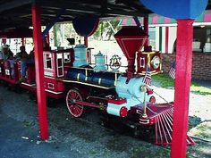 I loved this train growing up. I think it was because it crossed William's Grove Amusement Park out in the open across grass and paths and also went through the coaster and over the creek and back too.
