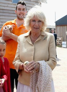 Camilla Parker Bowles Photos - Camilla, Duchess of Cornwall holds a chick as she visits Humble by Nature Farm on July 9 2015 in Monmouth, Wales. Humble by Nature is a working farm which was saved from closure by Kate Humble and her husband Ludo Graham in 2010. It includes a rural skills centre as well as a farm shop, cafe and adventure playground. - The Prince of Wales & Duchess of Cornwall Visit Wales - Day 4