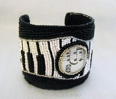 ~The Music in My Head~  This black and white bead embroidered bracelet started with a page from a vintage music book! I mounted the circle  $95.00