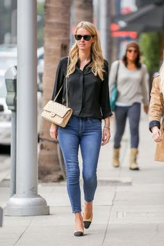Nicky Hilton wearing Ray-Ban Wayfarer Sunglasses, Chanel Slingback Pumps and Chanel Classic Flap Lambskin Bag in Beige