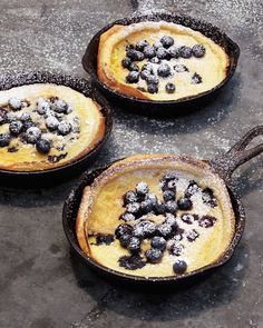 Blueberry Dutch Pancakes 4 large eggs 1 cup whole milk 1 cup all-purpose flour 1/4 cup granulated sugar 1/2 teaspoon finely grated fresh lemon zest 1/4 teaspoon salt 2 tablespoons unsalted butter 1 cup blueberries, plus more for topping Confectioners' sugar, for sprinkling