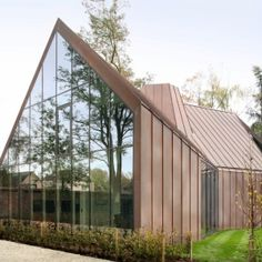 Located near Ghent, Belgium, House VDV is a distinctive residence created by Graux & Baeyens Architecten. The residence is at once rustic and modern with its form is not unlike a traditional barn or farmhouse. However, it integrates purely modern . Architecture Résidentielle, Contemporary Architecture, Brick Effect Wallpaper, Copper House, Glass Facades, Architect House, Design Case, Land Scape, Exterior Design