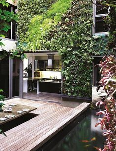 On Tuesday we showed you a vertical garden using moss. This one is clearly tropical. It is a great example of how vertical gardens overcome typical space limitations.    What do you think?