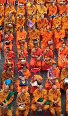A small fraction of the 20,000 Thai Buddhist monks that gathered for a mass alms-giving ceremony in downtown Bangkok, Thailand.