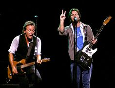 Eddie Vedder of Pearl Jam (R) joins Bruce Springsteen and the E Street Band during the Vote For Change concert at the Continental Airlines Arena October 13, 2004 in East Rutherford, New Jersey.