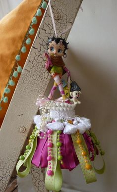 Betty Boop Tassel ~ I want to make some more of these. I have made a few in the past. This is a pretty one to use for design inspiration.