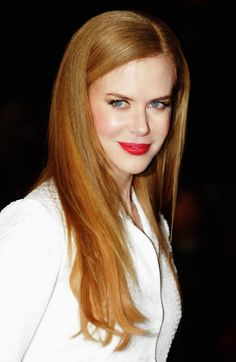 Nicole Kidman sporting long reddish blond hair and a winning smile
