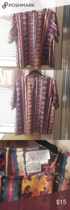 NWOT Colorful Aztec Print Top Short sleeve, keyhole back with button closure and shoulder pads.  Very lightweight, wrinkle free material. Tess Woman Tops Blouses