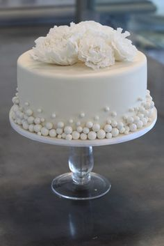 Excellent one to do in smoothed buttercream with buttercream ball border and removable gumpaste flowers. I like this for a wedding cake with the balls the color of the wedding.