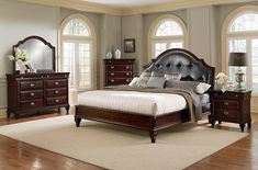 Tradition with a Twist. Exquisite detailing is the hallmark of our lovely Manhattan collection. Traditional elements like shaped pilasters, crown moulding and notched feet bring an air of classic sophistication to your bedroom. The eye-catching headboard is updated with tufted faux leather upholstery and nailhead trim, and a dark cherry finish and nickel hardware add a modern edge. The resulting look complements an array of home styles � from tried-and-true or slightly modern, to an eclectic c