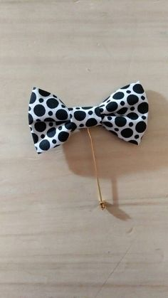 Check out this item in my Etsy shop https://www.etsy.com/listing/480603345/black-and-white-bowtie-lapel-pin-perfect