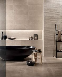 I love the textured walls in this minimalist bathroom