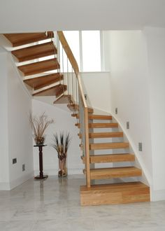 Enjoyable Curved Open Staircase With Wooden Steps Stairs As Well As Three Glass Windows In White Room Modern Design