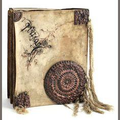 A rare Carlo Bugatti parchment, copper, silk, music folio circa 1900